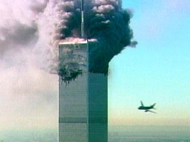 An aircraft at right about to fly into the the World Trade Center in New York in this image made from television, Tuesday Sept. 11, 2001. The aircraft was the second  to fly into the tower Tuesday morning. (AP Photo/ABC)  USA OUT TV OUT  NO CBC